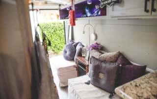 tiny house ottomans and purple pillows jypsy threads